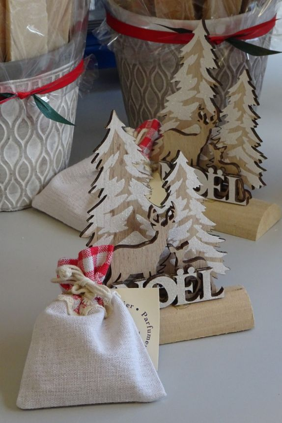 Christmas wooden decor with deer, frosted fir tree and log holder